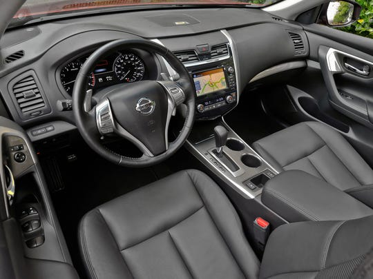 Inside the 2014 Nissan Altima, comfy heated leather seats, heated leather-wrapped steering wheel and nine-speaker Bose audio system do a good imitation of a luxury car.