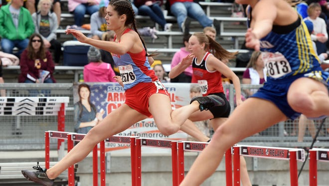 Lincoln's Ryley Heier takes the lead in the high school girls 300-meter hurdles during the Howard Wood Dakota Relays on Saturday, May 7, 2016.