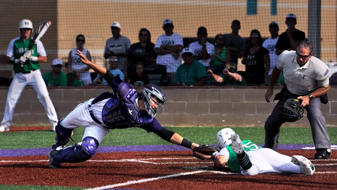 Wylie catcher Caleb Munton tags out Iowa Park's Noah Diaz at home plate Saturday at Bulldog Field. Wylie lost the Region 1-4A quarterfinals series, ending a bid for a third straight state championship.
