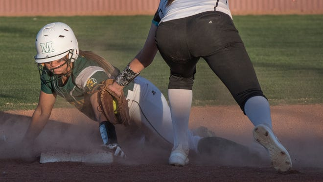 Mayfield's Jaelyn Zuniga easily beats the tag of Oñate's Samantha Barela for the stolen base Thursday night at the Field of Dreams Softball Complex.