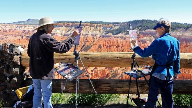 Parowan artist Valerie Orlemann and Cedar City artist Mary Jabens paint Friday at Cedar Breaks National Monument during the Arts Afire Plein Air Event and the Wildflower Festival.