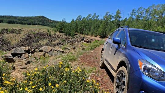 Brian Passey's Subaru Crosstrek stops near a basin