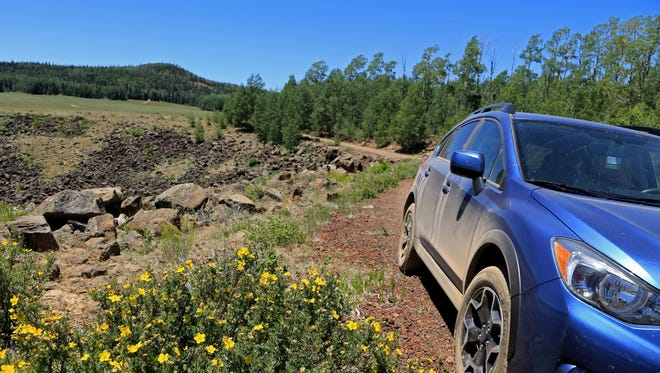 Brian Passey's Subaru Crosstrek stops near a basin of igneous rock along Forest Road 240 on the Markagunt Plateau (Cedar Mountain).