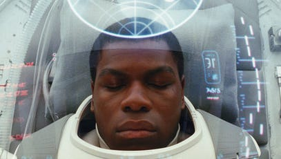 """This image released by Lucasfilm shows John Boyega as Finn in a scene from the upcoming """"Star Wars: The Last Jedi,"""" expected in theaters in December."""
