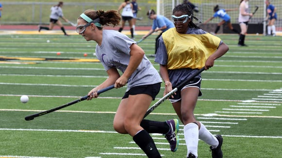 Caroline Cahill, a captain on the Lakeland High School Field Hockey team, is trailed by teammate Sophia Gloade during a practice at the school, Aug. 29, 2017.