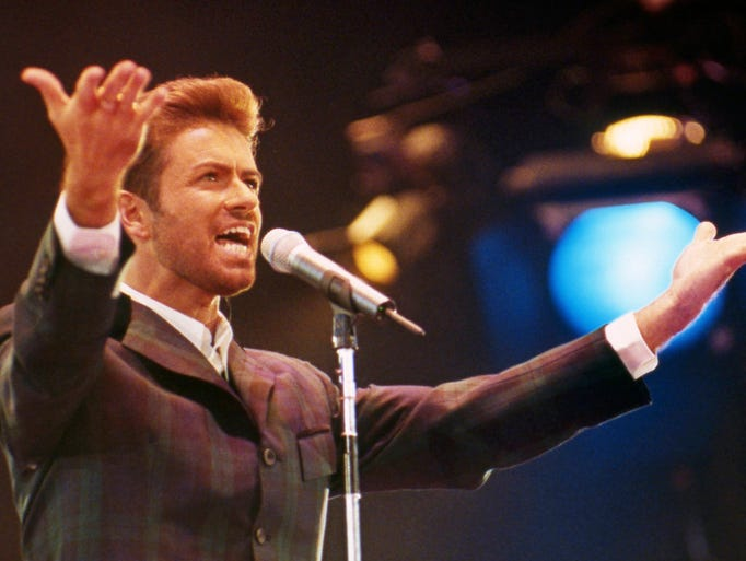 In this Dec. 2, 1993 photo, George Michael performs