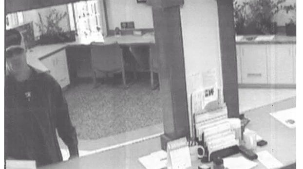 This is a surveillance photo of a man wanted for robbing a Westland Flagstar Bank Thursday morning.