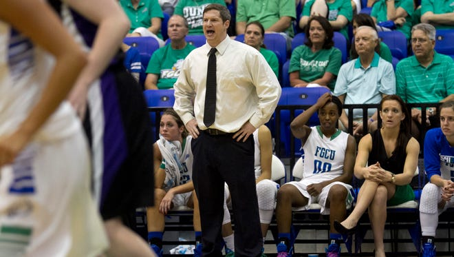 FGCU coach Karl Smesko instructs his players during the game against Lipscomb in the quarterfinals of the A-Sun Tournament on Tuesday at Alico Arena.