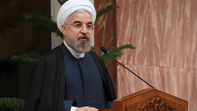 Iran's President Hassan Rouhani speaks during a news briefing after Iran and world powers agree in Geneva to a deal over Iran's nuclear program in Tehran, Iran, on  Nov. 24, 2013.