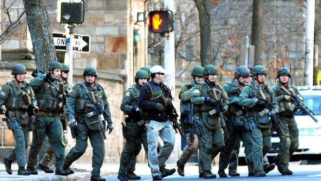 Police search Yale University on Nov. 25, 2013, after an anonymous 911 caller reported his roommate was headed to the New Haven, Conn. , campus with a gun. The school was locked down for more than six hours.