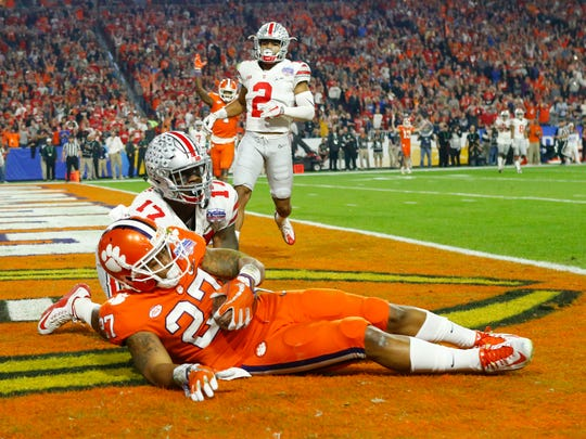 Clemson Tigers running back C.J. Fuller (27) scores a touchdown as Ohio State Buckeyes cornerback C.J. Saunders (17) defends during the second quarter of the College Football Playoff Semifinal game in the PlayStation Fiesta Bowl on Dec. 31, 2016 at University of Phoenix Stadium in Glendale, Arizona.