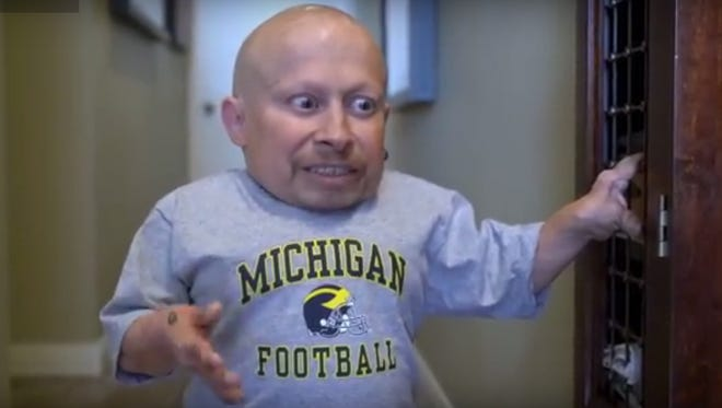 A hypnotist convinced Michigan fan Verne Troyer that he roots for Ohio State.