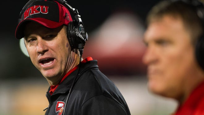 Nov 8, 2014; Bowling Green, KY, USA; Western Kentucky University head coach Jeff Brohm shouts down his sideline in the fourth quarter of their game against UTEP at Houchens Industries-L.T. Smith Stadium. WKU would go on to win 35-27. Mandatory Credit: Brian Powers-USA TODAY Sports