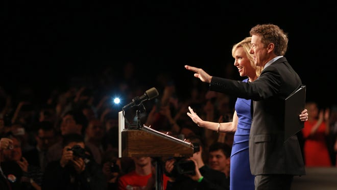 Sen. Rand Paul, R-Ky., and his wife, Kelley, wave to supporters during an event announcing his candidacy for the Republican presidential nomination at the Galt House Hotel on April 7, 2015 in Louisville, Ky.