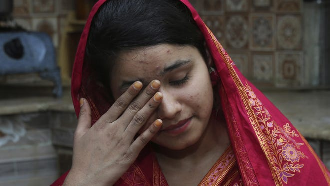 In this April 14, 2019 photo, Mahek Liaqat weeps while she recounts her ordeal in an arranged marriage to a Chinese national, in Gujranwala, Pakistan.