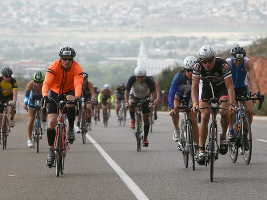 Ironman 70.3 St. George participants ride their bikes through St. George Saturday, May 7, 2016.