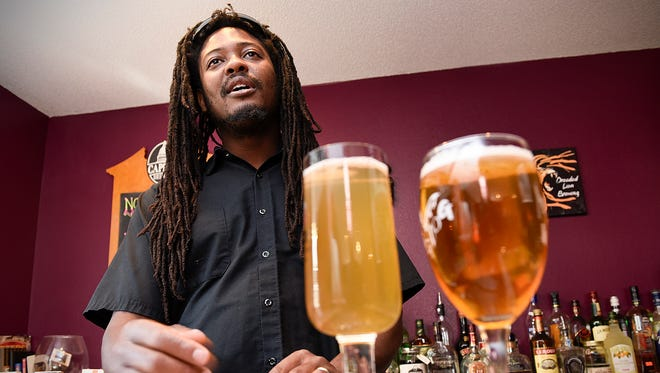 Desi Hall talks about his new store The Hop Shop Thursday, Oct. 6, that he and his wife Lori will be opening in St. Cloud. Their homebrew supply store will be in Midtown Square Mall.