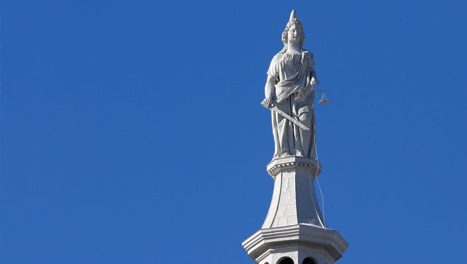 Lady Justice atop the dome of the Tippecanoe County Courthouse Thursday, January 4, 2018, in downtown Lafayette.
