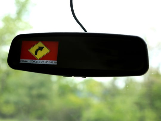A warning system pops up with an alert warning the driver that he was taking a corner too fast during a demonstration.