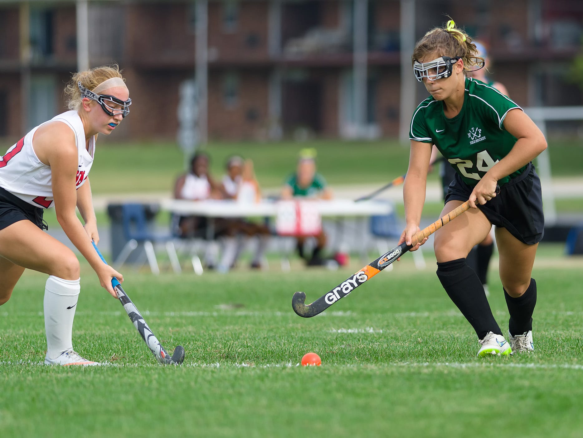Kylee Balbach (24) of Mt. Pleasant drives the past the William Penn defense in the William Penn vs Mt. Pleasant field hockey game at William Penn on Tuesday.