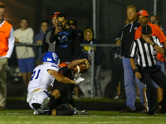 CC senior Chris Jakubik tackles Rice quarterback Mariano