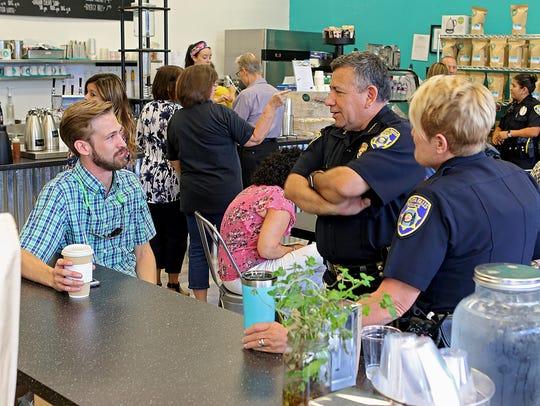 Cameron Lynn (left) talks with Wichita Falls Police