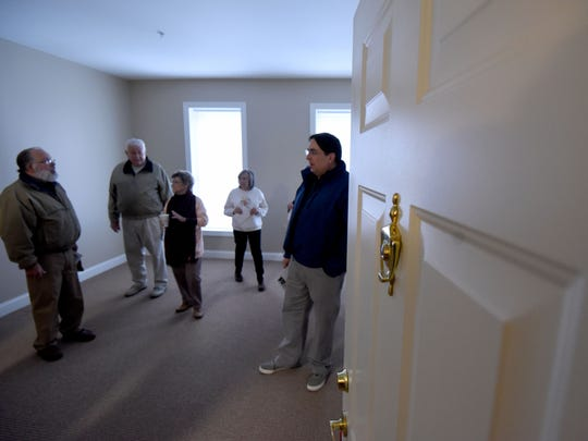 Visitors tour a one bedroom apartment at the Central Hotel on Monday morning. The building at 10 Public Square in Galion is now low-income housing for senior citizens.