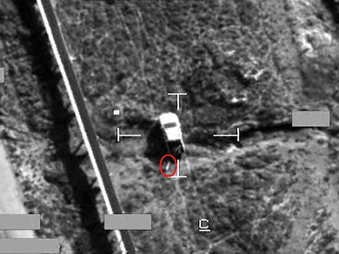 A photograph from the British Ministry of Defense shows the result of a Brimstone missile strike on an armed Islamic State truck on Sept. 30 in Iraq. The Brimstone missile is circled in red moments before impact.