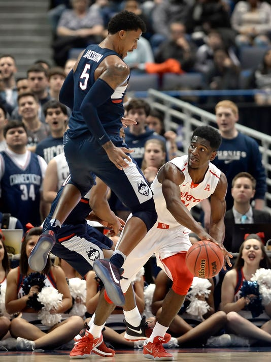 Connecticut's Vance Jackson, left, guards Houston's Damyean Dotson, right, during the first half of an NCAA college basketball game in the American Athletic Conference tournament quarterfinals, Friday, March 10, 2017, in Hartford, Conn. (AP Photo/Jessica Hill)