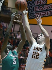 McCutcheon senior Kelden Tyson gets an inside shot
