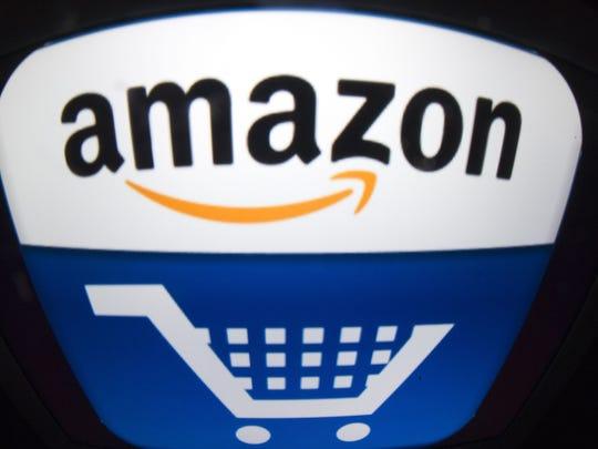 Lionel Bonaventure,  AFP/Getty Images The Amazon logo..co
