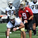 New Orleans Saints quarterback Drew Brees (9)  lines up behind center Marcus Henry during the NFL football teams  training camp in White Sulphur Springs, W.Va., Thursday.