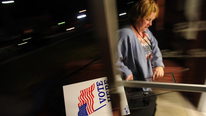 Accomack election official Jennifer Langley returns voting equipment to the Accomack County Voter Registrar's Office in Accomack County after her precinct closed on Election Day, Tuesday, Nov. 4, 2014.