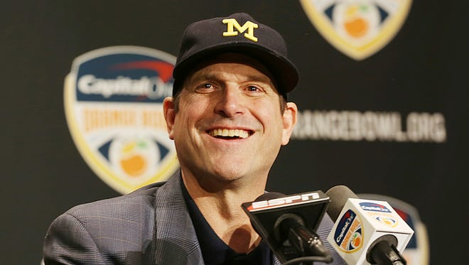 Michigan head coach Jim Harbaugh smiles during a news conference in Fort Lauderdale, Fla., Thursday, Dec. 29, 2016. Michigan plays Florida State in the Orange Bowl Friday.