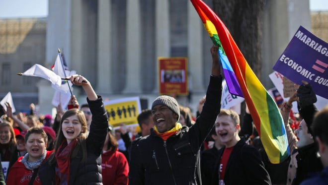 Demonstrators chant outside the Supreme Court in Washington, Tuesday, March 26, 2013, as the court heard arguments on California's voter approved ban on same-sex marriage, Proposition 8.