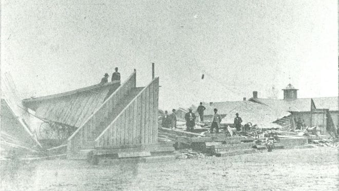 The grandstand collapse in 1879 killed around 20 people and injured hundreds more. The stairway, which did not collapse, led to spectator seating some 10 or so feet above the field. The two men to the left are standing on what was once the roof of the structure. This photo was taken from the field in front of the grandstand.