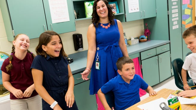 Maureen Zaranek, a first-year teacher at Corkscrew Elementary, shares a laugh with students in her fifth grade Cambridge Program class as they participate in a fun warmup activity early Wednesday, Aug. 16, 2017, in Golden Gate Estates. The 2017-18 school year marks the first year the program for high-achieving students will be available to grades three through five who qualify.