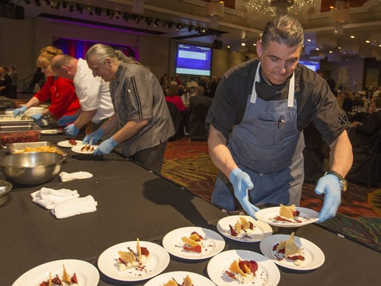 Chef Mark Estee prepares a dish for the Big Chefs, Big Gala fundraiser for Big Brothers Big Sisters local chapter  held at the Grand Sierra Resort on Saturday night, April 30, 2016.