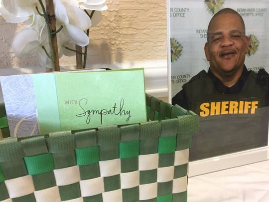 A small memorial for slain Corrections Deputy Garry Chambliss is set up in the lobby at the Indian River County Jail on Saturday, Feb. 18, 2017.