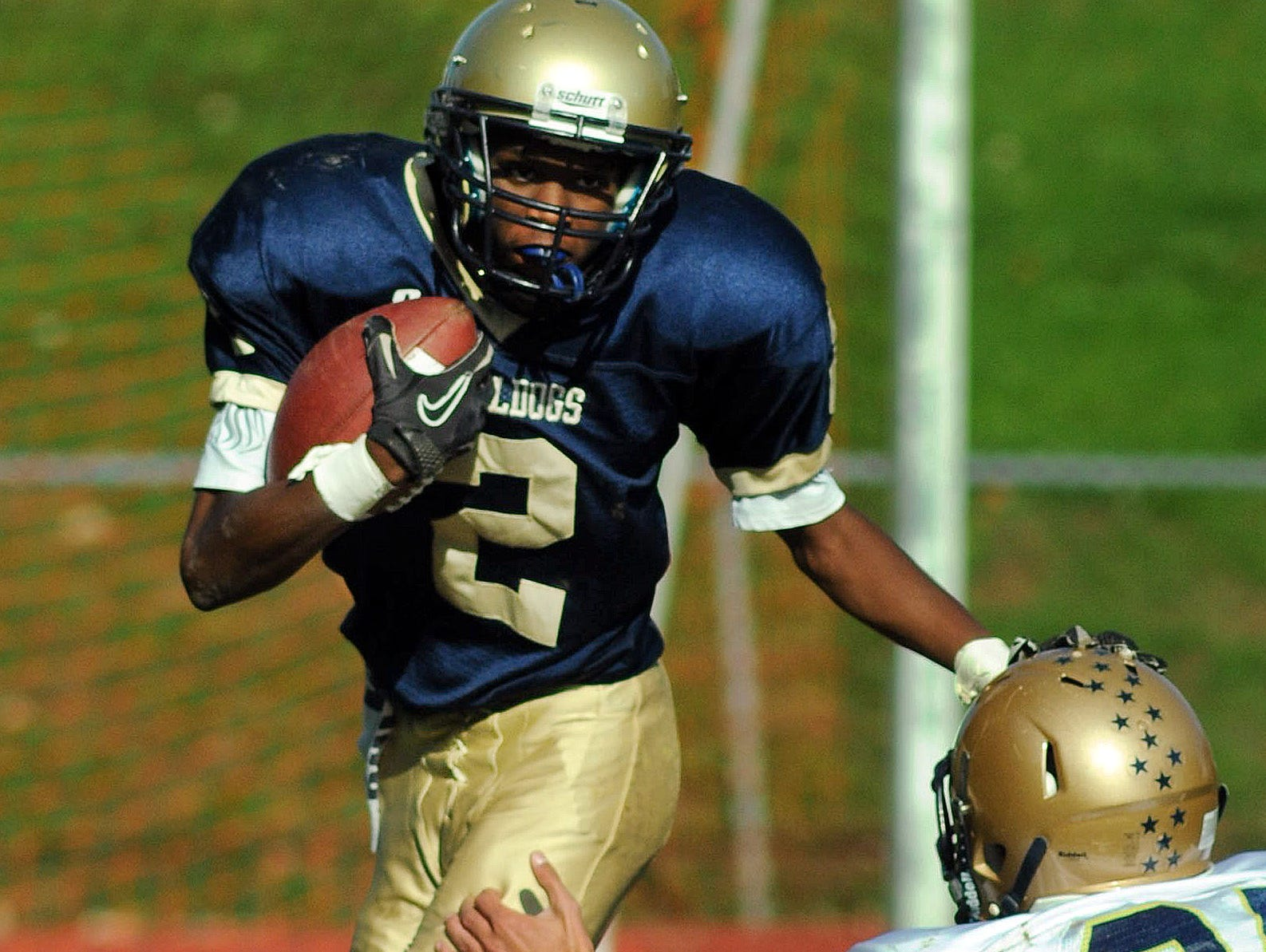 Beacon High School's Davon Cousar attempts to run around a tackle during the last game between Beacon and Our Lady of Lourdes before Saturday, held Oct. 20, 2012.