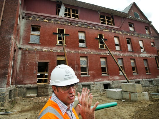 Project Administrator Mike Stevens gives a tour of the renovation and reconstruction of the Waterbury office complex on Wednesday. The complex was flooded by the Winooski River three years ago during Tropical Storm Irene.