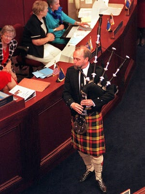 With bagpipe in hand, Ron James entertains members of the legislature in 1997 where they voted in Assembly bill 362 making April 6 Tartan Day in Nevada.
