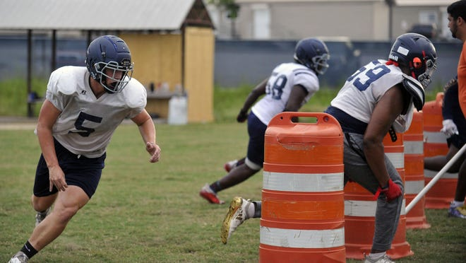 Hunter Thomason (5) goes through defensive line drills during practice on Aug. 14, 2020 at Grovetown High School. Thomason will look to make a difference on both sides of the ball for the Warriors.