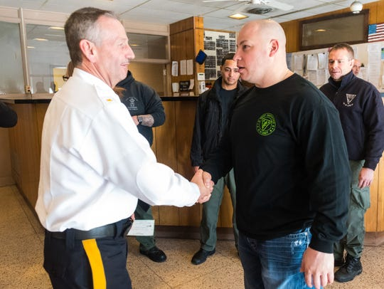 Vineland Police Chief Rudy Beu shakes hands with West Deptford Sgt. Mike Franks at the Vineland Police Station on Tuesday, January 9.