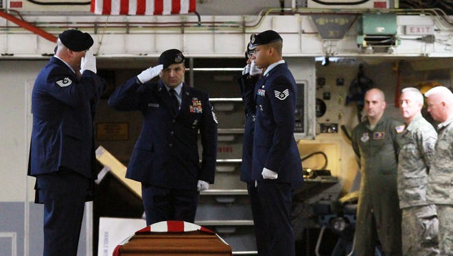 Airmen carry the flag draped coffin of TSGT. Joseph Lemm after it arrived at Stewart Air Force Base in Newburgh on Dec. 28, 2015.