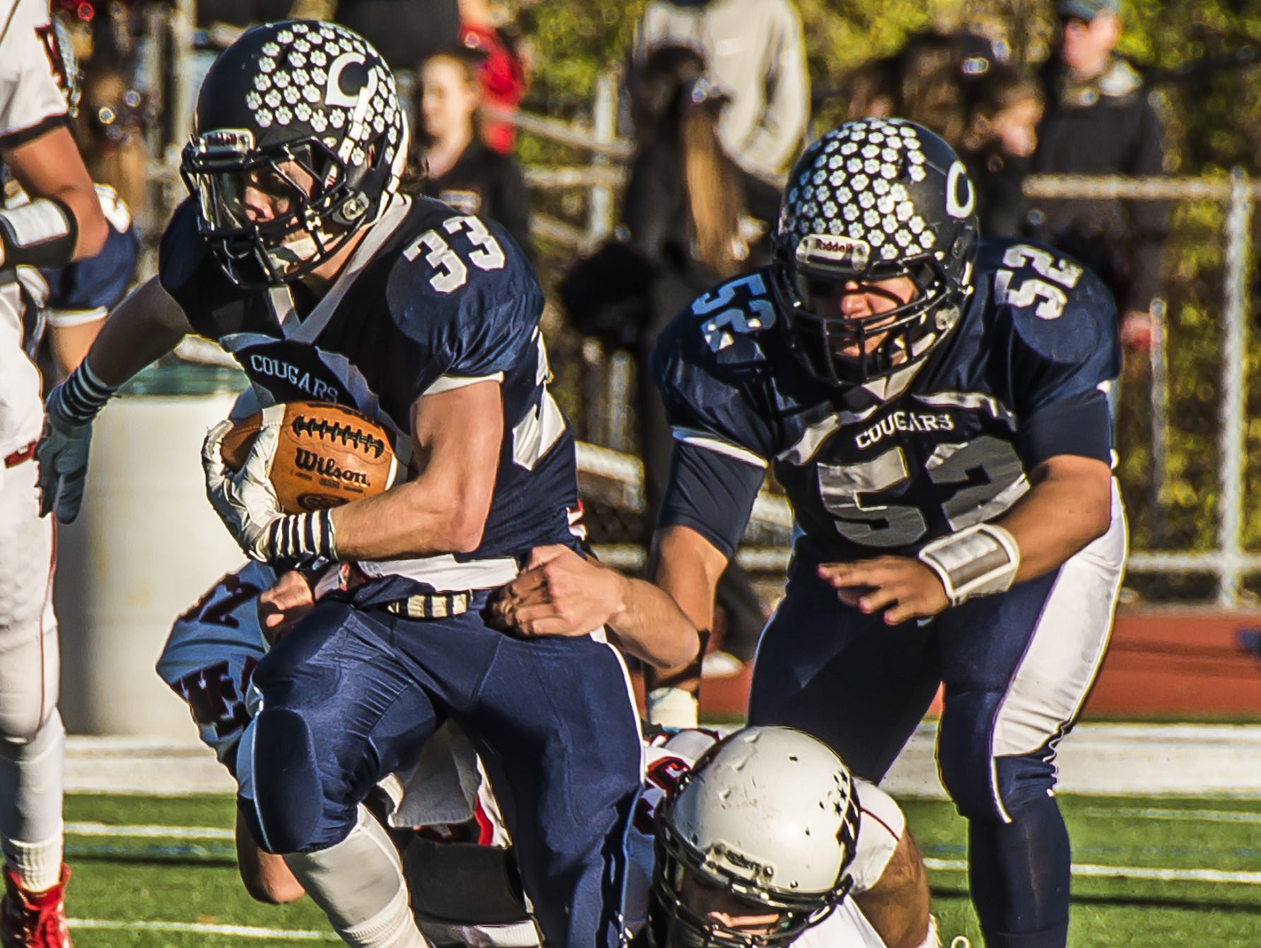 Chatham's Justin Hayes (33) is caught from behind by West Essex defenders Anthone Leone (33) and Timothy Kitchen (52) at the NJSIAA North 2 Group III West Essex at Chatham football game at Chatham, November 21, 2015. (Photo by Warren Westura for the Daily Record)