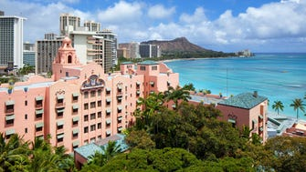 The historic Royal Hawaiian sits on Waikiki Beach on the Hawaiian island of Oahu.