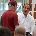 "Marcus Lemonis, CEO and Chairman of Camping World and host of CNBC's TV show, ""The Profit,"" surprises an RV owner with a gift certificate Friday, July 31, 2015, during the Camping World Richmond SuperCenter opening."