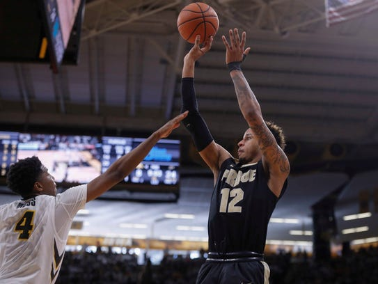 Purdue senior Vincent Edwards fires a three-point field