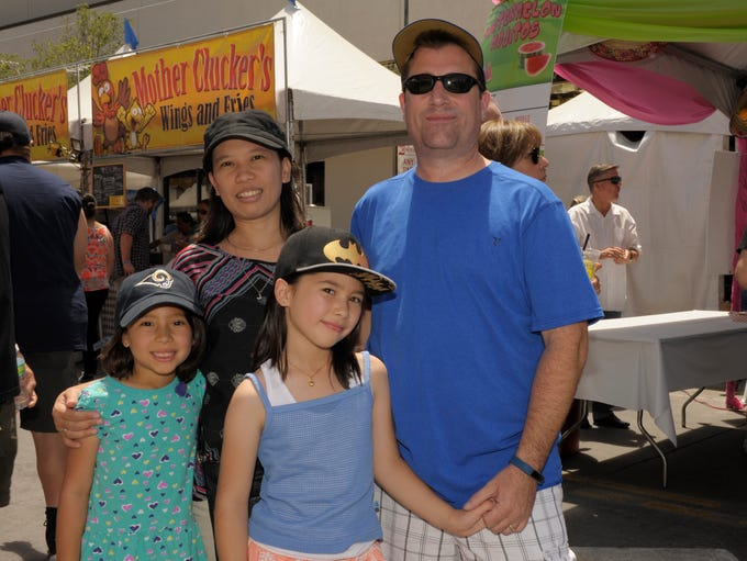 Maddie, 8, left, Jennie, Jikea, 9, and Mike Robin attend